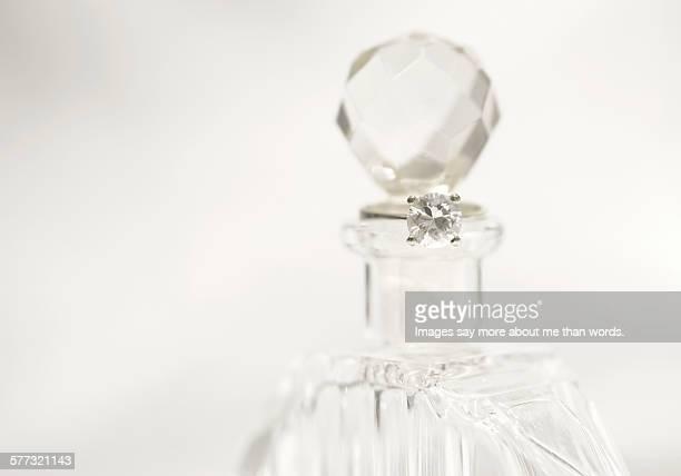 Perfume and diamond ring.