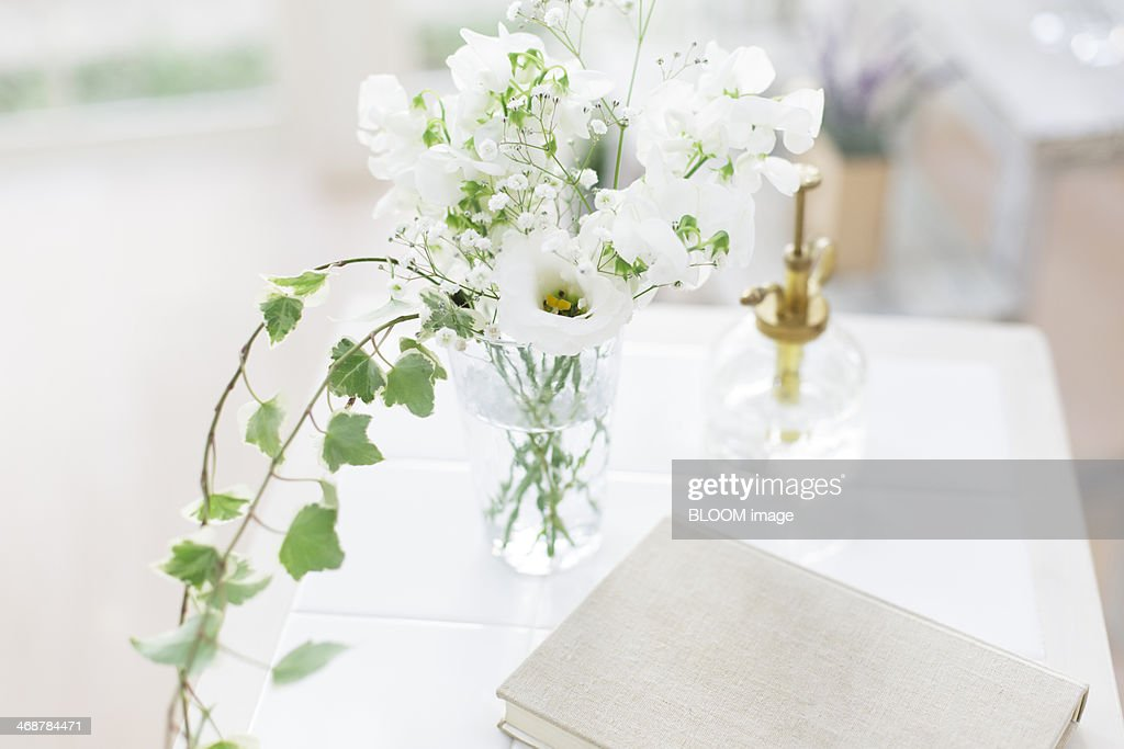 Perfume bottle diary and white flowers in vase stock photo getty perfume bottle diary and white flowers in vase stock photo mightylinksfo