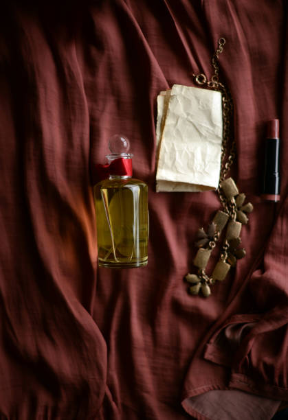 Perfume bottle, necklace and lipstick