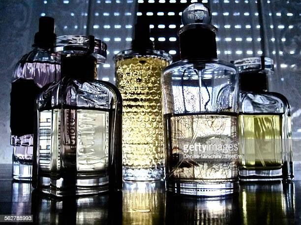 Perfume Bottles On Table At Home