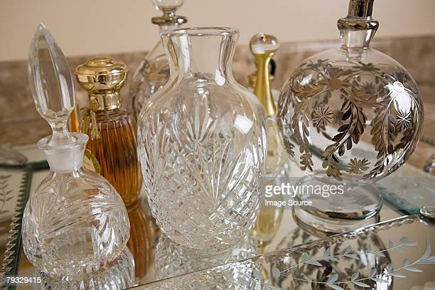 perfume bottles - dressing table stock photos and pictures