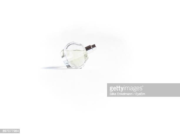 perfume sprayer against white background - perfume stock pictures, royalty-free photos & images