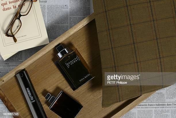 Perfumes For Men Les parfums pour hommes l'intello flacons de parfum OJ PERRIN M7 d'Yves SAINT LAURENT et MEMOIRE D'HOMME de Nina RICCI sur un...