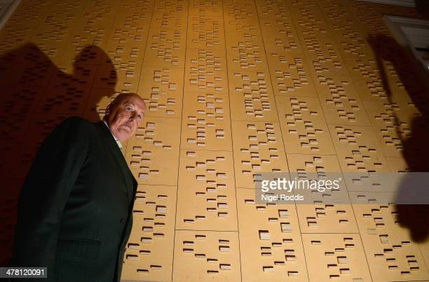 Pergrine Cavendish, Duke of Devonshire poses for a photograph between panels of ceramic blocks which represent his DNA, by artist Jacob Van der...