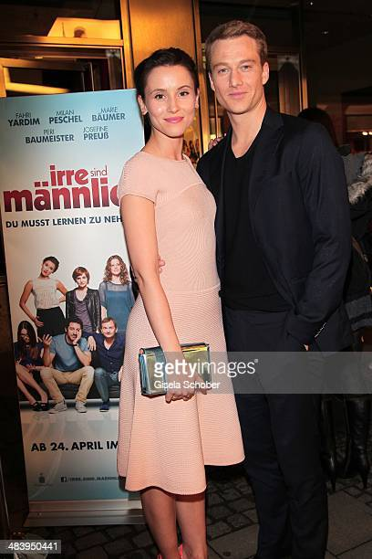 Peri Baumeister and her boyfriend Alexander Fehling attend the premiere of the film 'Irre sind maennlich' at Mathaeser Filmpalast on April 10 2014 in...