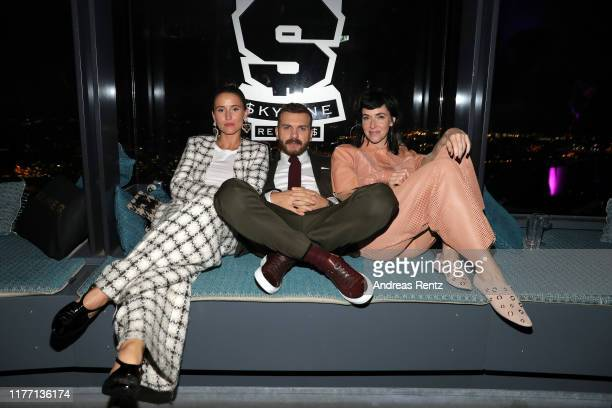Peri Baumeister Edin Hasanovic and Kim Riedle attend the premiere of the new Netflix series Skylines on September 25 2019 in Frankfurt am Main Germany