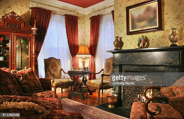 Period style furniture next to fireplace in yellow sitting room