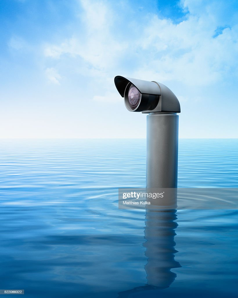 Periscope Above Sea Stock Photo