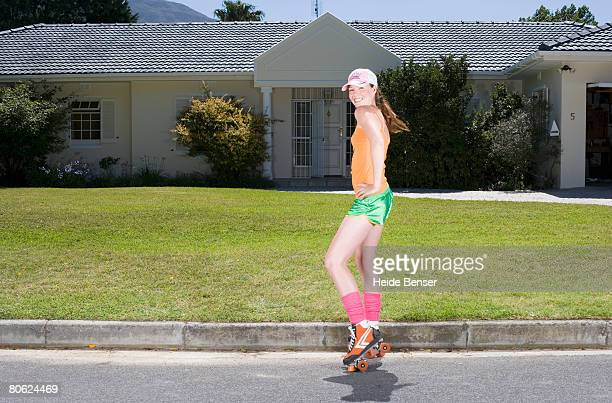 Perky Teenager on Roller Skates in Front of House