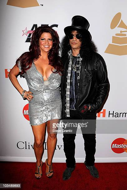 Perla Hudson and musician Slash arrive at the 52nd Annual GRAMMY Awards Salute To Icons Honoring Doug Morris held at The Beverly Hilton Hotel on...