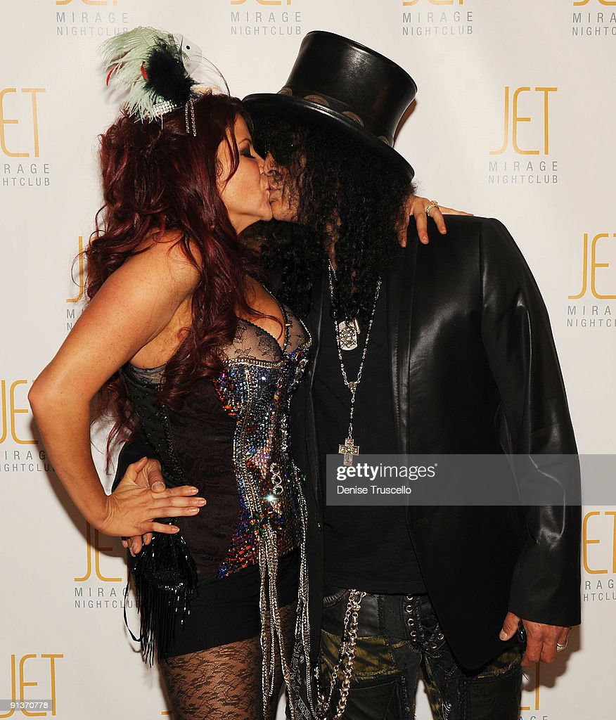 Perla Hudson and Slash arrives at Jet Nightclub at The Mirage on October 2, 2009 in Las Vegas, Nevada.
