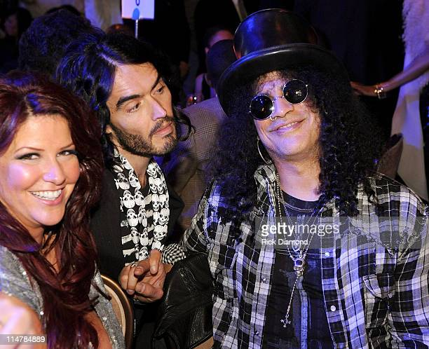 Perla Hudson comedian Russell and musician Slash attend the 52nd Annual GRAMMY Awards Salute To Icons Honoring Doug Morris held at The Beverly Hilton...