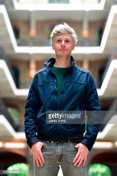 Permafungi's owner and CEO Julien Jacquet poses for a picture at his company which recycles coffee grounds to grow organic mushrooms in Brussels on...
