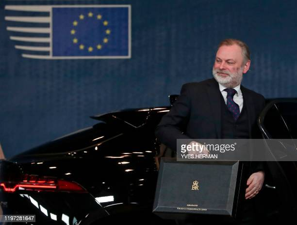 Permanent Representative of the United Kingdom to the European Union Sir Tim Barrow arrives to deposit the instrument of ratification notifying the...