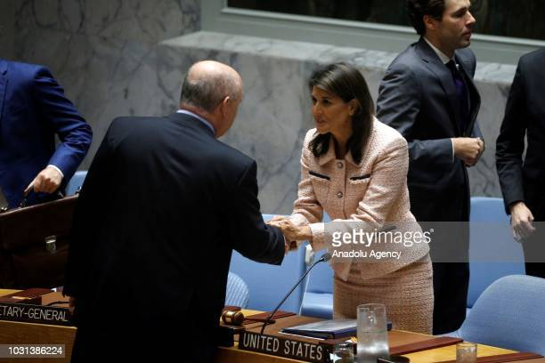 Permanent Representative of Turkey to the United Nations Feridun Hadi Sinirlioglu shakes hands with US Ambassador to the United Nations Nikki Haley...