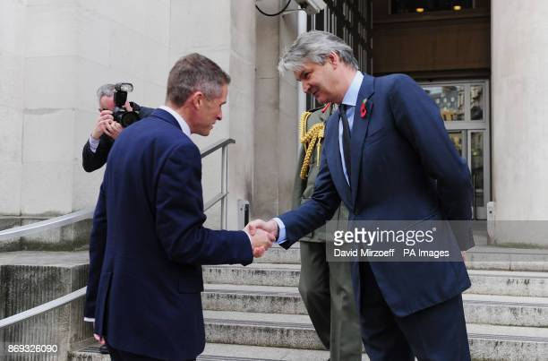 Permanent Secretary at the Ministry of Defence Stephen Lovegrove greets Gavin Williamson outside the Ministry of Defence in London after he was named...