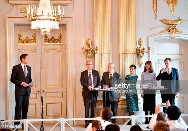 Permanent Secretary of the Swedish Academy Mats Malm and the members of the Nobel Committee for Literature Chairman Anders Olsson Per Wastberg...