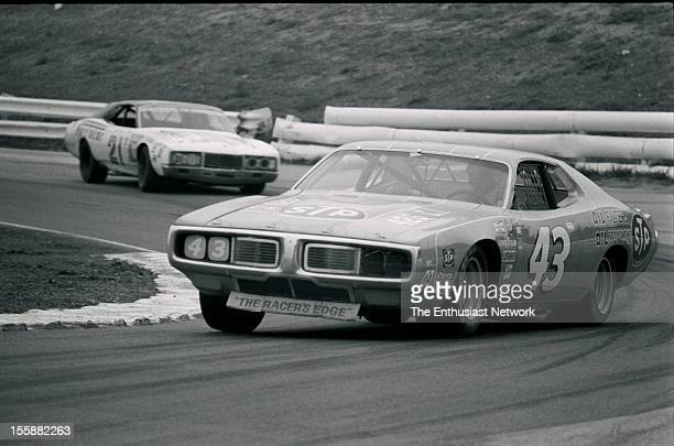 Permatex 200 1974 NASCAR Winston Western 500 Second place finisher Richard Petty in his Dodge Charger leads David Pearson in his Purolator Mercury
