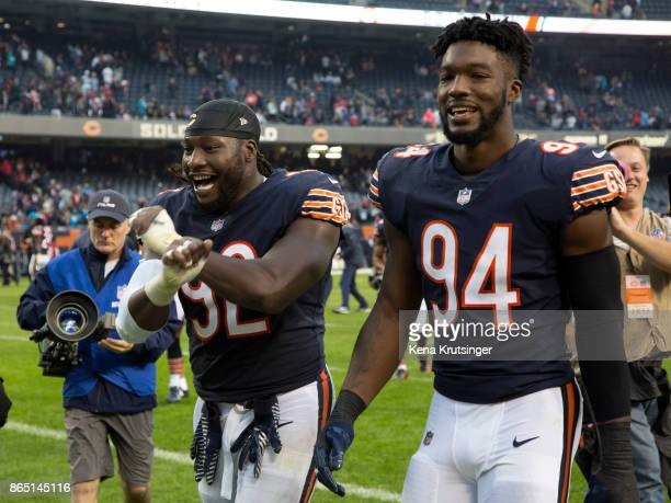 Pernell McPhee and Leonard Floyd of the Chicago Bears walk off of the field after the Bears defeated the Carolina Panthers 173 at Soldier Field on...