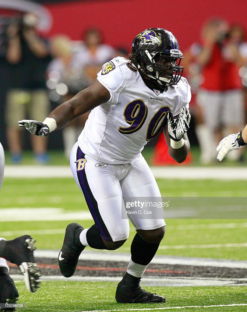 Pernell McPhee #90 of the Baltimore Ravens rushes the Atlanta Falcons at Georgia Dome on September 1, 2011 in Atlanta, Georgia.