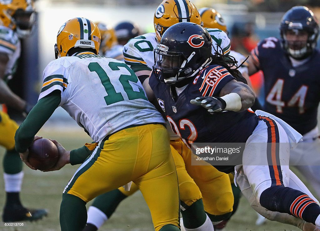 Pernell McPhee #92 of the Chicago Bears sacks Aaron Rodgers #12 of the Green Bay Packers in the fourth quarter at Soldier Field on December 18, 2016 in Chicago, Illinois. The Packers defeated the Bears 30-27.