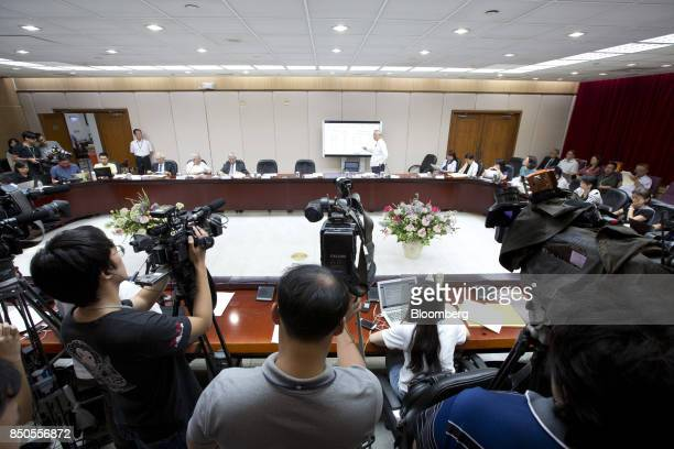 Perng Fai-nan, governor of the Central Bank of the Republic of China , center, speaks during a news conference in Taipei, Taiwan, on Thursday, Sept....