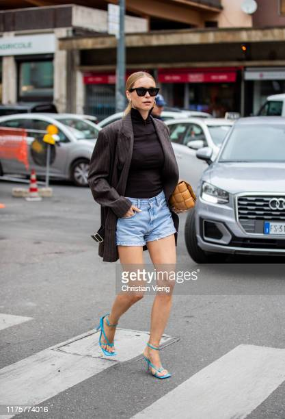 Pernielle Teisbaek is seen wearing striped blazer denim jeans shorts brown Bottega Veneta cross body bag turquois sandals outside the Max Mara show...