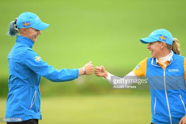 Pernilla Lindberg and Madelene Sagstrom of Sweden celeberate on the 15th hole in the Pool B match between Japan and Sweden on day two of the UL...