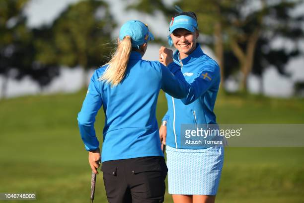 Pernilla Lindberg and Madelene Sagstrom of Sweden celebrates winning the match on the 17th green in the Pool B Match between Thailand and Sweden on...