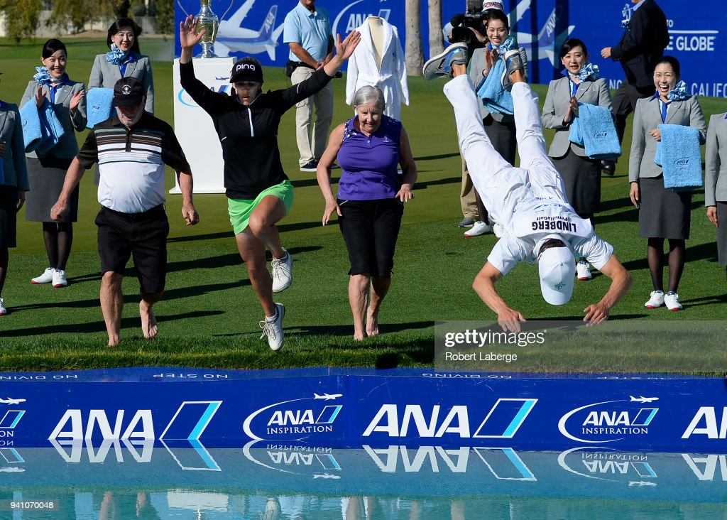 Pernilla Lindberg of Sweden jumps into the water with her fiance Daniel Taylor and her parents Jan and Gunilla Lindberg after winning the the ANA Inspiration on the Dinah Shore Tournament Course at Mission Hills Country Club on April 2, 2018 in Rancho Mirage, California.