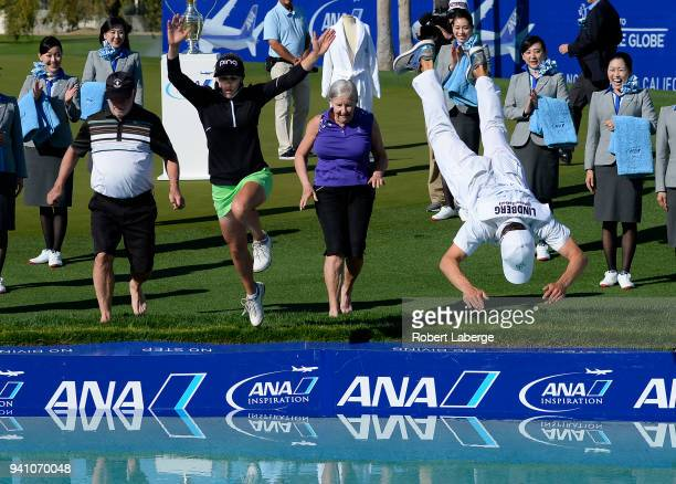 Pernilla Lindberg of Sweden jumps into the water with her fiance Daniel Taylor and her parents Jan and Gunilla Lindberg after winning the the ANA...
