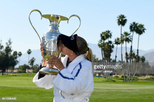 Pernilla Lindberg of Sweden kisses the winner's trophy after defeating Inbe Park of South Korea during the sudden death playoff on the eighth hole...