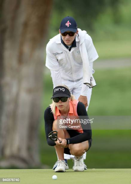 Pernilla Lindberg of Sweden lines up a birdie putt with her caddie and fiancee Daniel Taylor on the 11th green during the third round of the 2018 ANA...
