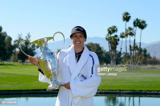 Pernilla Lindberg of Sweden poses with the winner's trophy after defeating Inbe Park of South Korea during the sudden death playoff on the eighth...