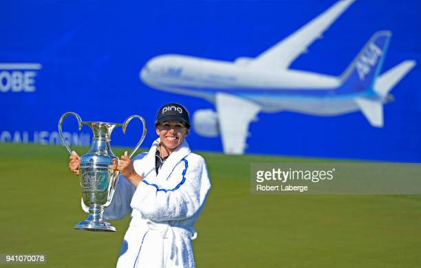 Pernilla Lindberg of Sweden poses with the winner's trophy after winning the the ANA Inspiration on the Dinah Shore Tournament Course at Mission...