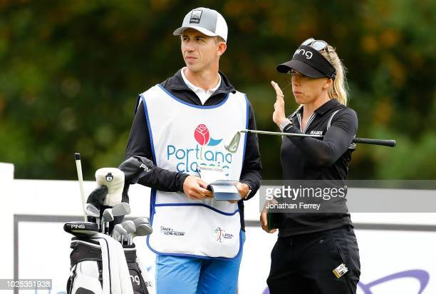 Pernilla Lindberg of Sweden talks to her caddie on the 2nd hole during the first round of the LPGA Cambia Portland Classic at Columbia Edgewater...