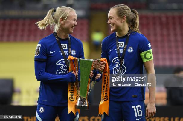 Pernille Harder and Magdalena Eriksson of Chelsea celebrate with the FA Women's Continental Tyres League Cup Trophy following their team's victory in...