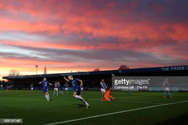 Pernille Harder of Chelsea celebrates after scoring her team's first goal as the sun sets around the stadium during the FA Women's Continental League...