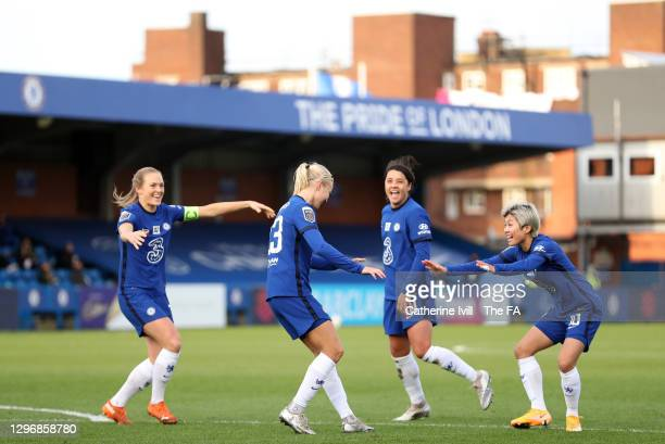 Pernille Harder of Chelsea celebrates and social distances with team mates Magdalena Eriksson, Sam Kerr and Ji So-Yun after scoring their side's...