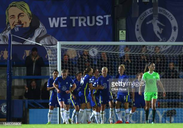 Pernille Harder of Chelsea celebrates with Magdalena Eriksson and Sophie Ingle after scoring their side's third goal during the UEFA Women's...