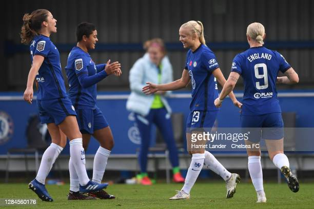 Pernille Harder of Chelsea celebrates with teammates after scoring her team's fourth goal during the Barclays FA Women's Super League match between...