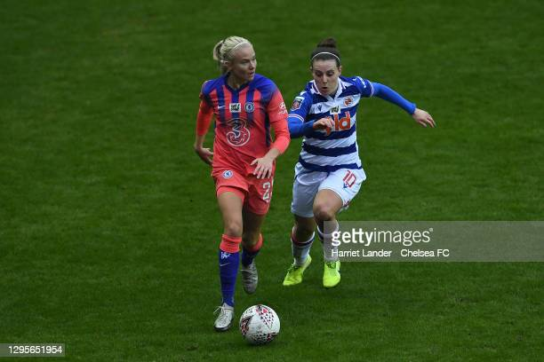 Pernille Harder of Chelsea is challenged by Lauren Bruton of Reading during the Barclays FA Women's Super League match between Reading Women and...