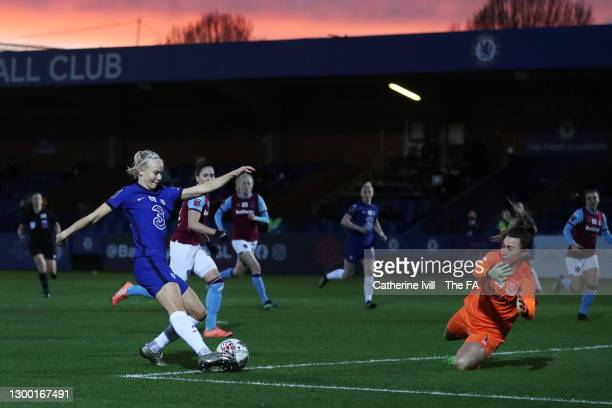 Pernille Harder of Chelsea scores her team's first goal past Mackenzie Arnold of West Ham United during the FA Women's Continental League Cup Semi...