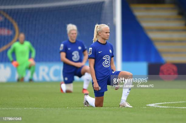 Pernille Harder of Chelsea takes a knee in support of the Black Lives Matter Movement prior to the Barclays FA Women's Super League match between...