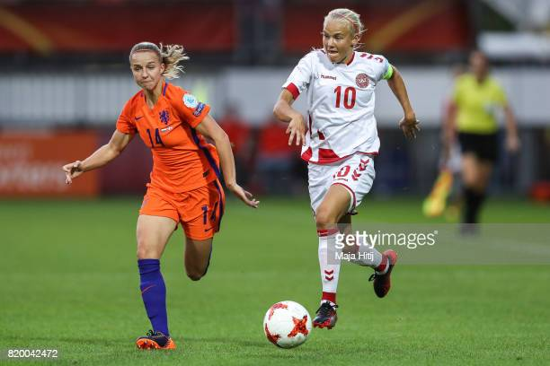 Pernille Harder of Denmark and Jackie Groenen of the Netherlands battle for the ball during the UEFA Women's Euro 2017 Group A match between...
