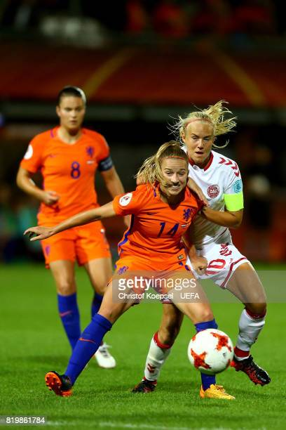 Pernille Harder of Denmark challenges Jackie Groenen of the Netherlands during the UEFA Women's Euro 2017 Group A match between Netherlands and...