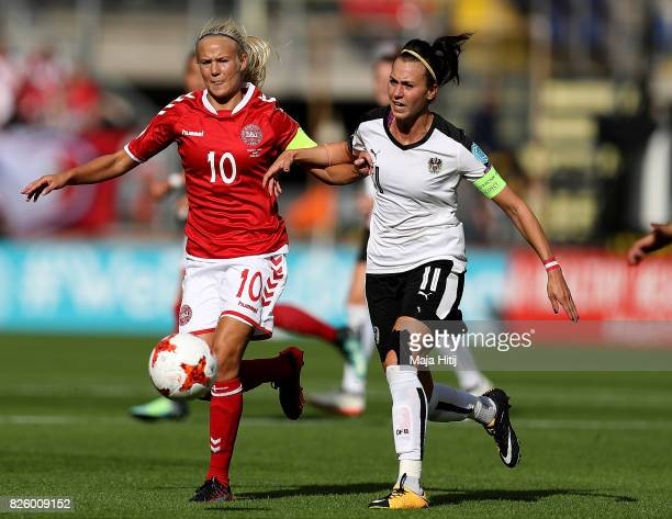 Pernille Harder of Denmark holds odd pressure from Viktoria Schnaderbeck of Austria during the UEFA Women's Euro 2017 Semi Final match between...