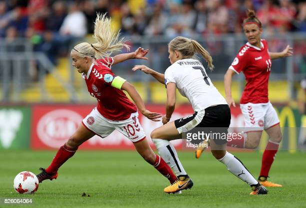 Pernille Harder of Denmark holds off pressure from Carina Wenninger of Austria during the UEFA Women's Euro 2017 Semi Final match between Denmark and...