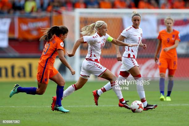 Pernille Harder of Denmark holds off pressure from Danielle van de Donk of the Netherlands during the Final of the UEFA Women's Euro 2017 between...