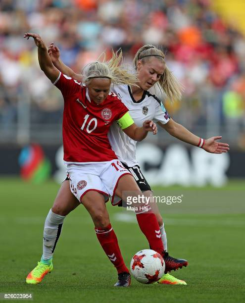 Pernille Harder of Denmark holds off pressure from Sarah Putigam of Austria during the UEFA Women's Euro 2017 Semi Final match between Denmark and...